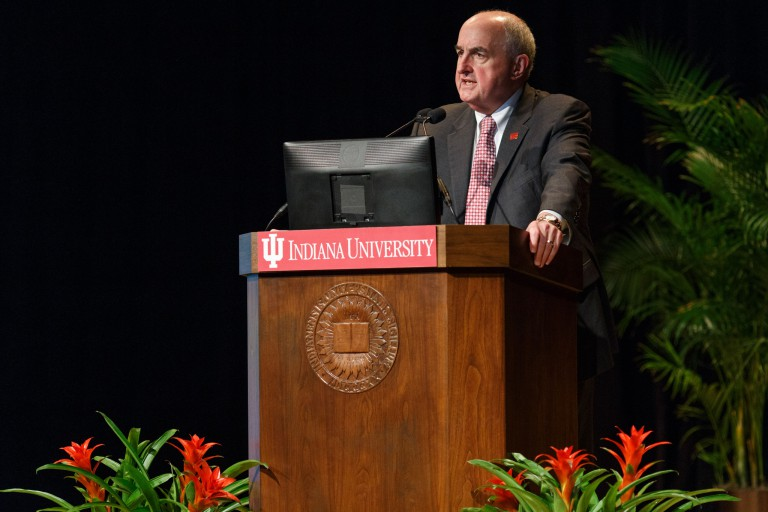 IU President Michael A. McRobbie speaking at a podium