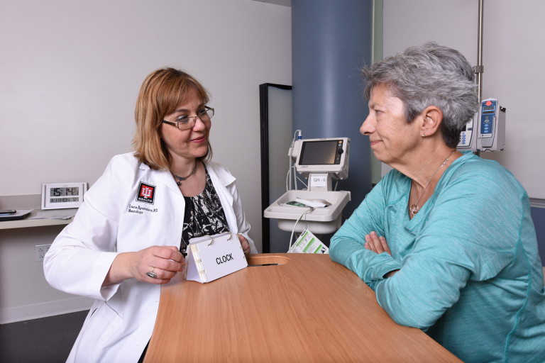 Alzheimer's doctor and patient talking to each other
