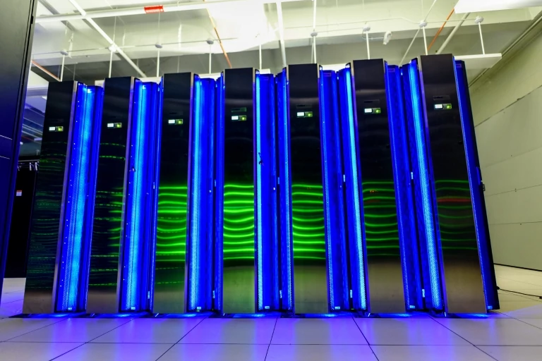 Illuminated blue CPU towers of the Jetstream cloud computing system