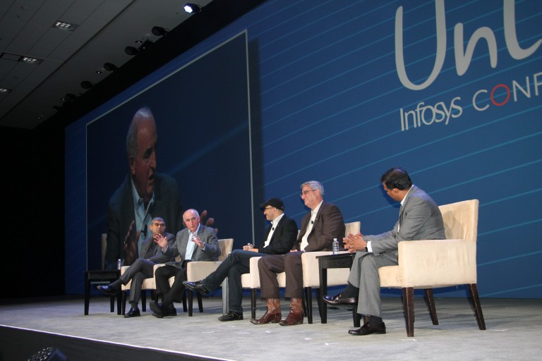 President McRobbie on stage during a panel with other speakers