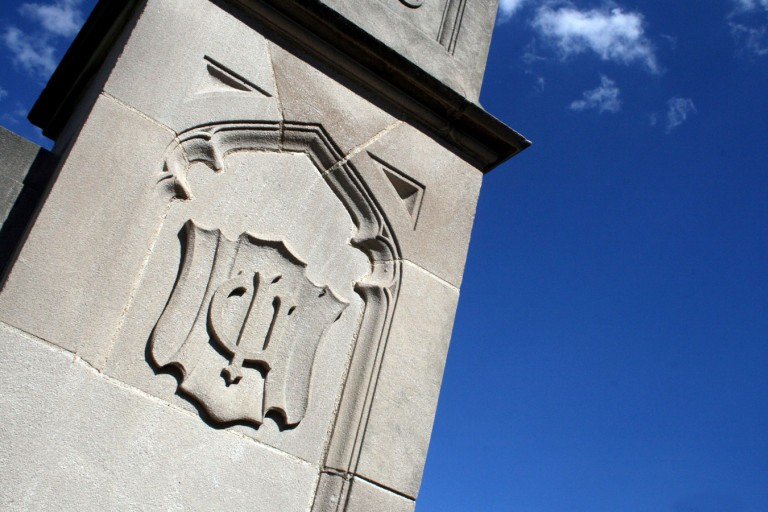 Indiana University trident symbol on limestone building