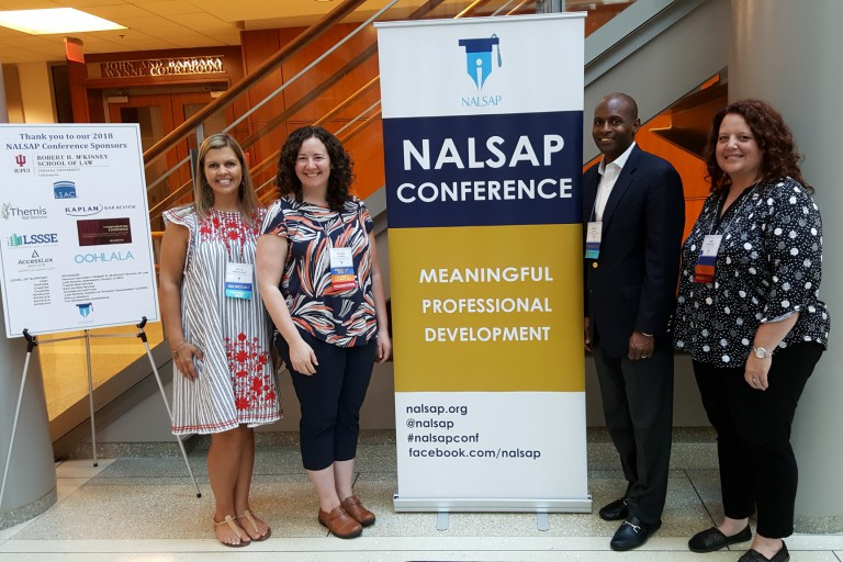 Professionals stand outside of the (NALSAP) conference