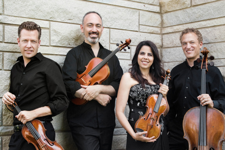 Members of the Pacifica Quartet holding their instruments