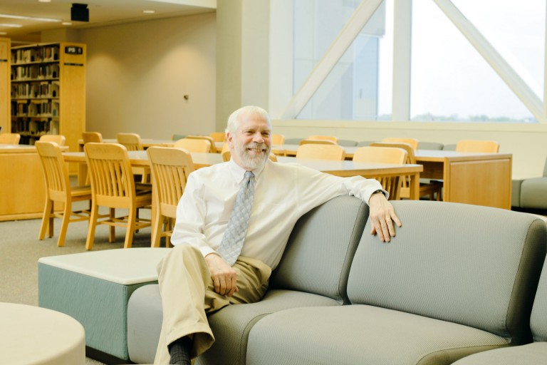 David Lewis sitting in the library
