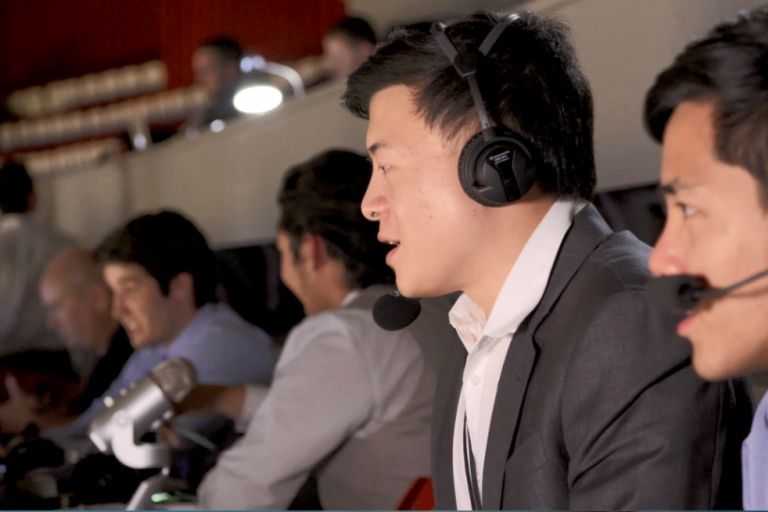 One of the members of the IU Mandarin Radio Club broadcasts during a basketball game
