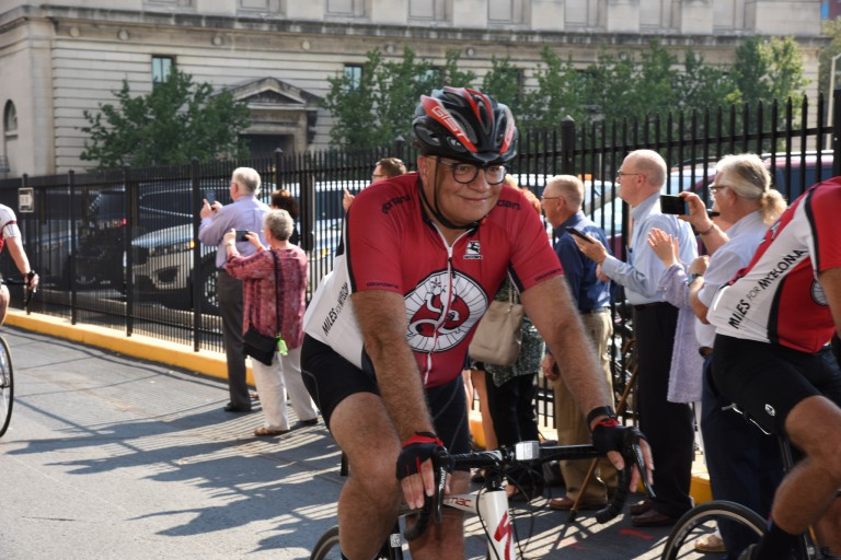 Dr. Rafat Abonour on a bicycle in the Miles for Myeloma event.