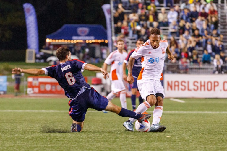 Indy Eleven soccer player kicks the ball during a game at Carroll Stadium at IUPUI