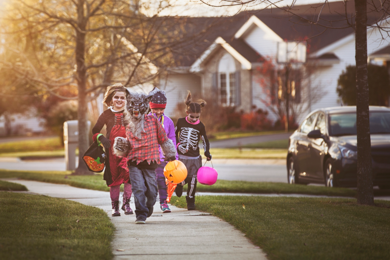 Children dressed in Halloween costumes trick-or-treating