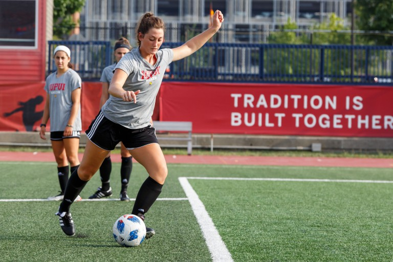IUPUI soccer player goes for a kick.