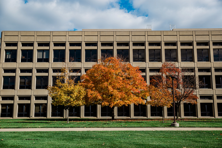 The exterior of the Engineering and Technology building with fall foliage.