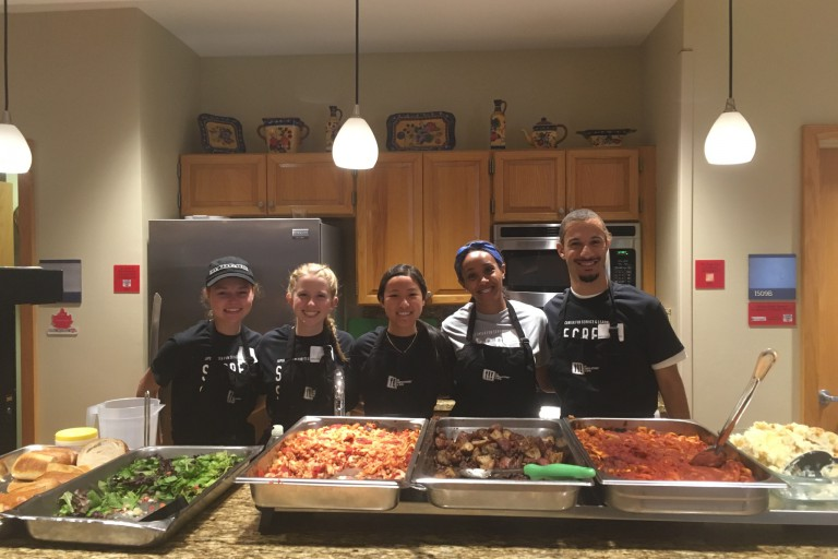 IUPUI Campus Kitchen student volunteers with trays of food.
