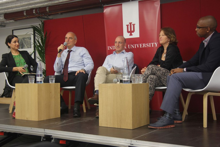Four panelists speak at a conference at the IU Europe Gateway