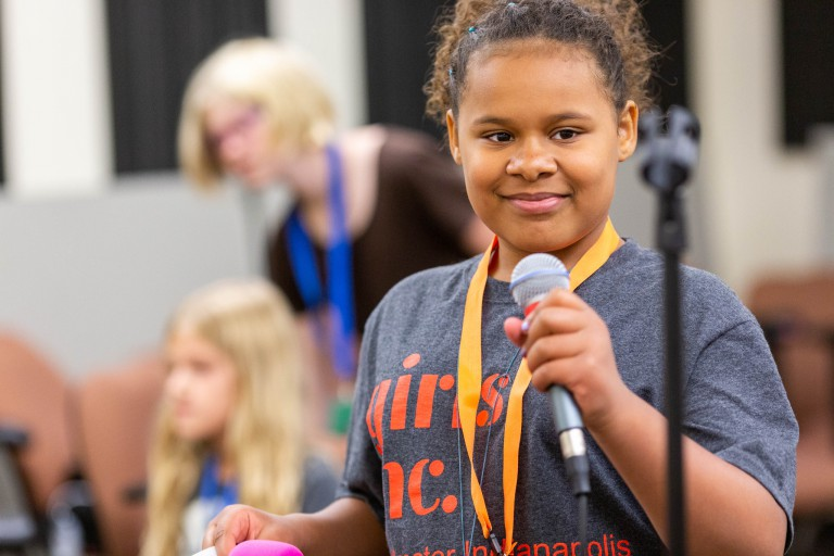 A girl practices her vocals at Girls Rock Indianapolis camp.