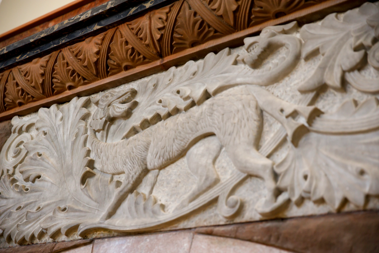 A detail on a fireplace inside Maxwell Hall