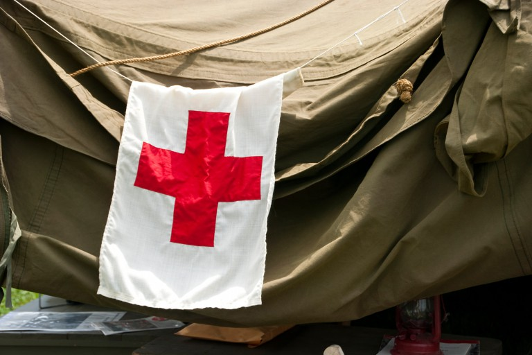 Red Cross flag hanging on a tarp