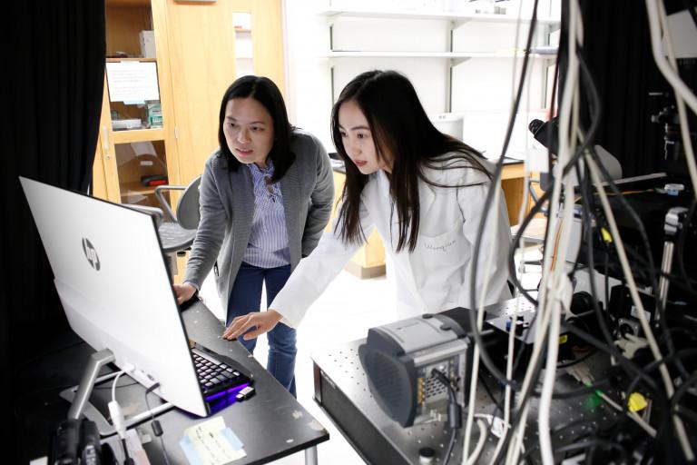 Yan Yu and Wenqian Li in the lab