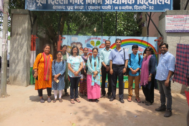 Khalid Khan with a group in front of a school in India