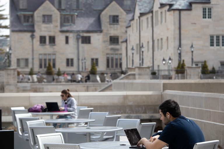 Students work at tables outside the IMU on the Bloomington campus
