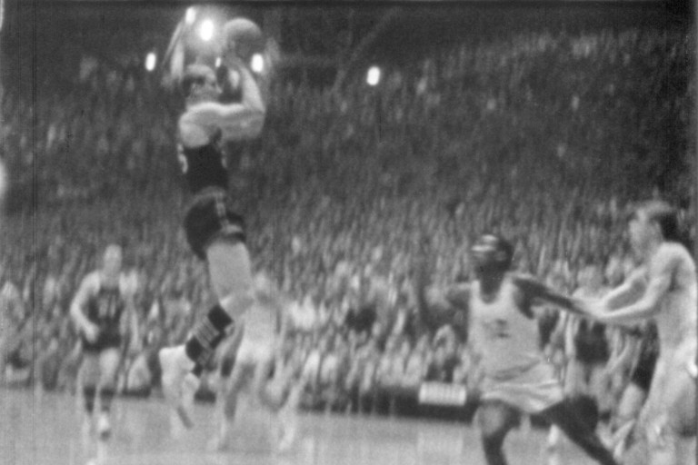 A scene from one of the 1954 basketball games featuring Milan High School.