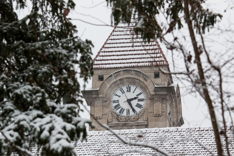 A snow-covered clock tower.