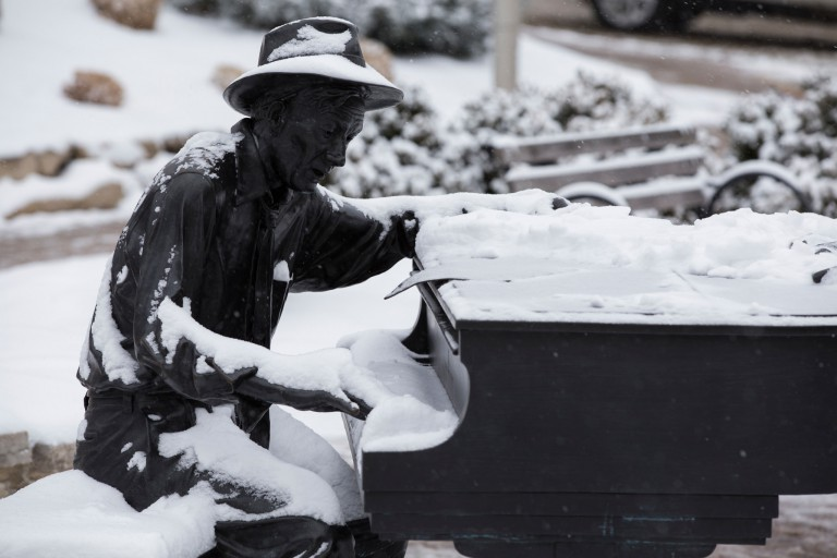 Hoagy Carmichael statue covered in snow