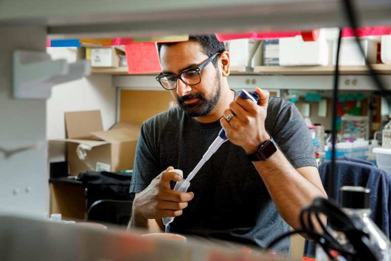 Ankur Dalia uses a pipette in the lab