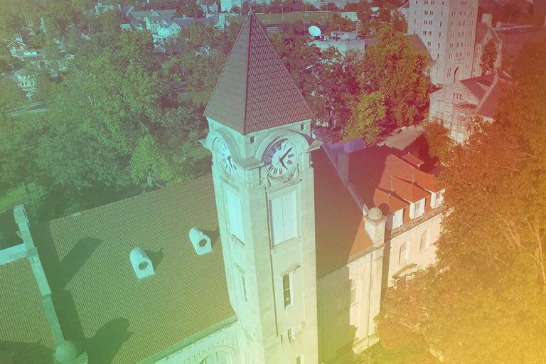 An aerial view of the Student Building on the IU Bloomington campus with a rainbow color overlay