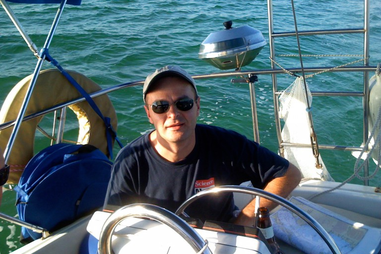 "Dan Tracey on his boat, ""Sea Salt."""