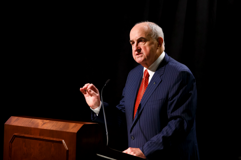 Indiana University President Michael McRobbie speaks at a podium