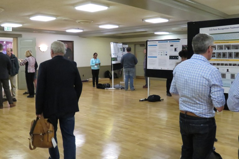Attendees of the 2017 Bloomington Innovation Conference review research posters.