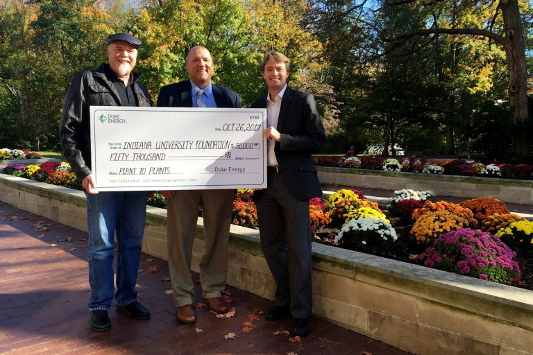 Chip, Bruce and Mark holding a giant check from Duke.