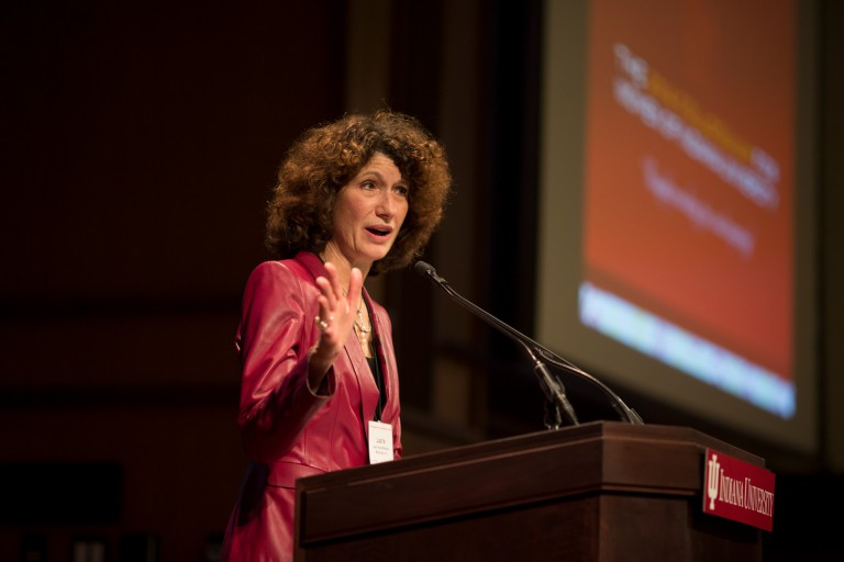 Laurie Burns McRobbie speaks at a podium