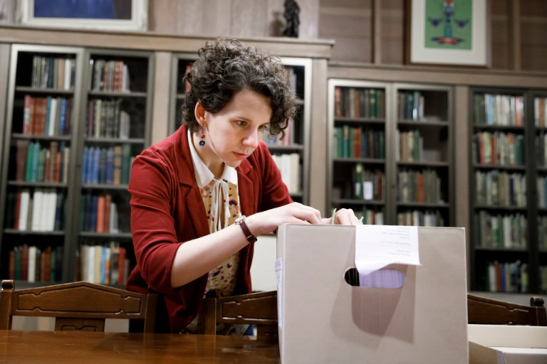 Isabel Planton searching through Vonnegut materials