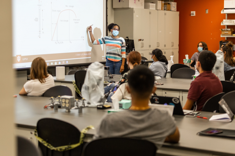 A teacher in a science classroom