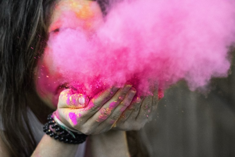 A pink burst of powder from Holi Festival