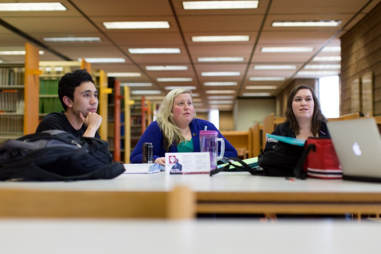 Students have a discussion at the library