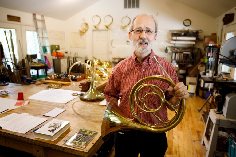 Rick Seraphinoff holds a French horn
