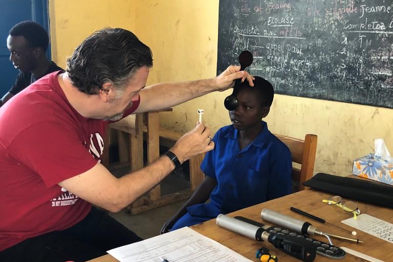 Don Lyon performs an eye exam