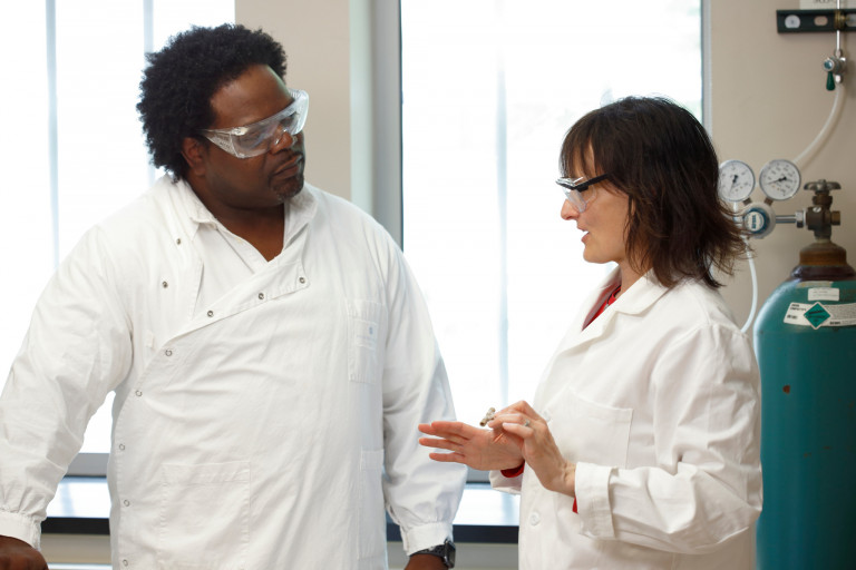 Dean Rowe-Magnus, left, and Nicola Pohl discuss their antimicrobial peptide for diabetic foot ulcers