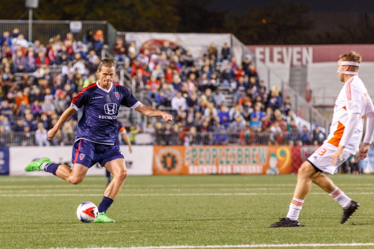 An Indy Eleven player kicks the ball.