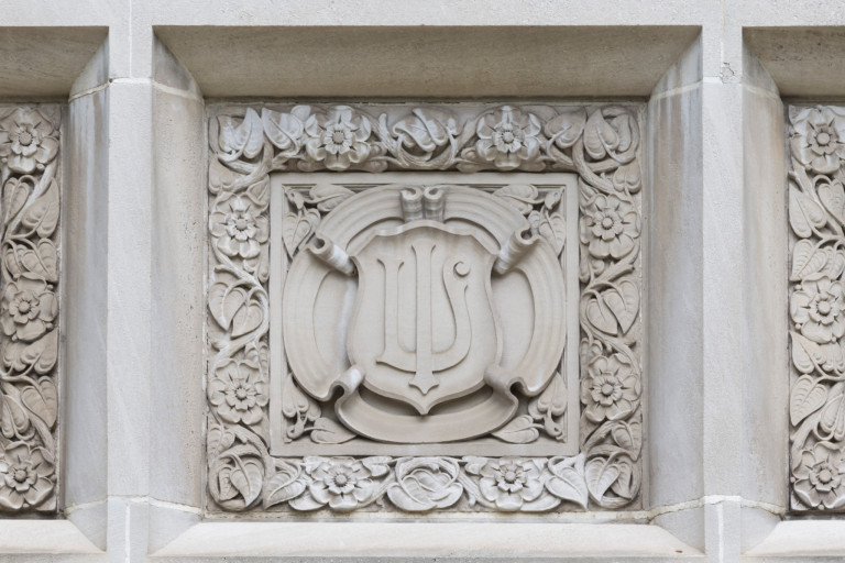 The IU trident on the exterior of Rawls Hall