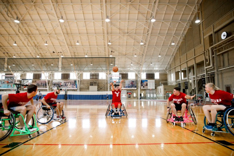 Students playing basketball in wheelchairs