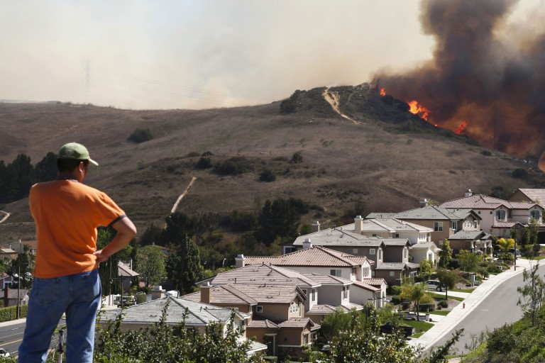 A wildfire threatens a suburb
