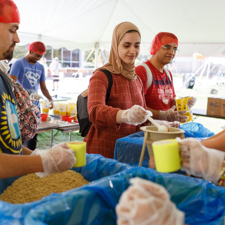 Students pack meals for the Million Meal Movement.