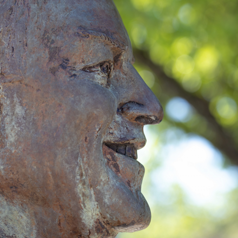 A profile view of the bust of Bill Armstrong.