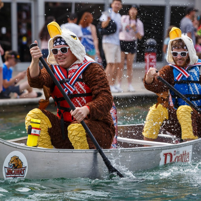 Students dressed up in eagle costumes to paddle their canoe down the canal.