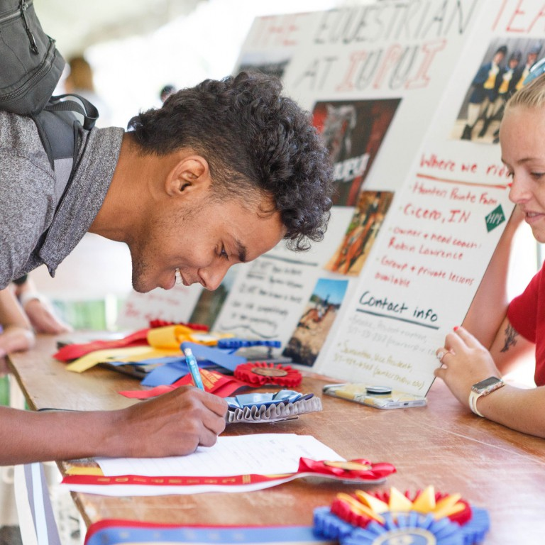 An IUPUI student signs up to join a student organization at the Fall Involvement Expo.