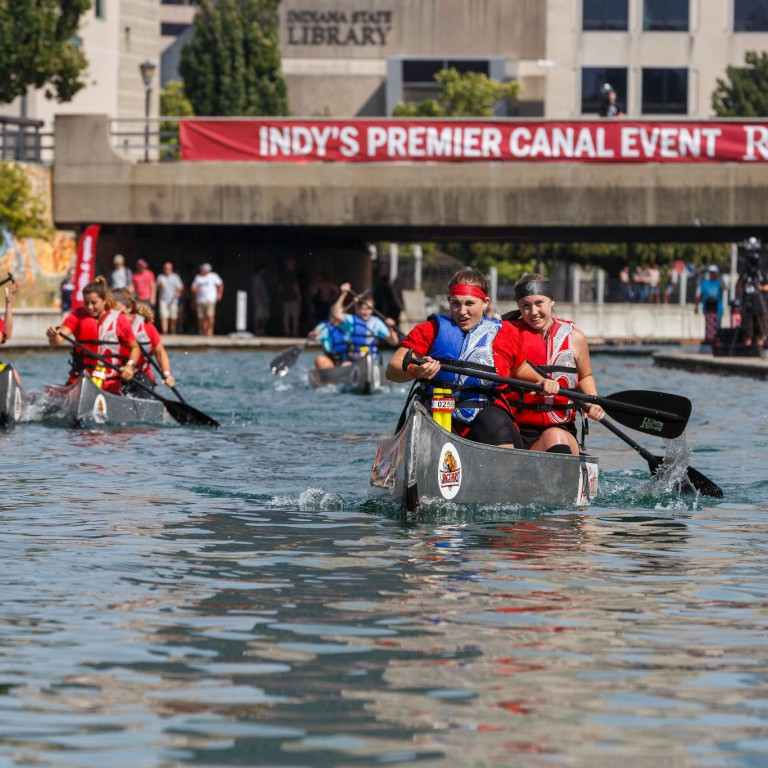 Canoe teams battle it out to the finish line.