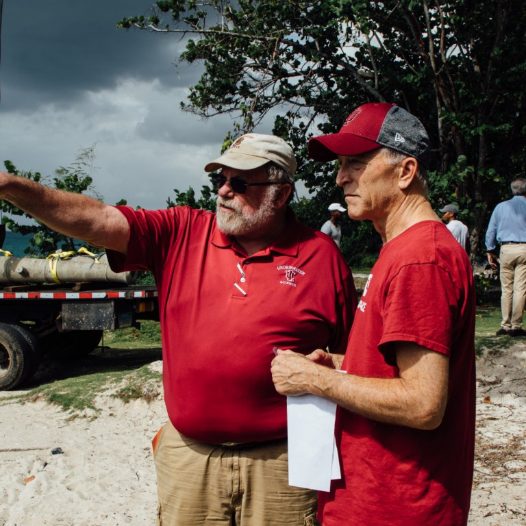 Charles Beeker points as he discusses with Doug Rose the location of the underwater museum