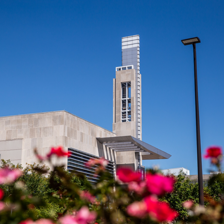 a view of the Campus Center framed with colorful flowers